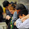 Sandrino Oliver (near left) and Luz Oliver (near right) embrace each other with family members standing by during a vigil for their missing 5-year-old nephew, Jeremiah Oliver of Fitchburg, Thursday night at New Creation Community Church on Boulder Drive in Fitchburg.<br /> SENTINEL & ENTERPRISE / BRETT CRAWFORD
