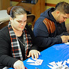 Fitchburg residents Judy Sanchez, 31, and Henry Morales, 21, write prayers and decorate paper angels for missing 5-year-old Jeremiah Oliver of Fitchburg, Thursday at the Elm Street Community Church.<br /> SENTINEL & ENTERPRISE / BRETT CRAWFORD
