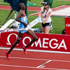 Asbel Kiprop, Kenya crosses the mile finish line in 3:49.40