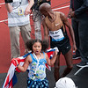 Mo Farah, Great Britain as his daughter Rhianna celebrates.<br /> won the London 2012 Olympics 10,000m Gold
