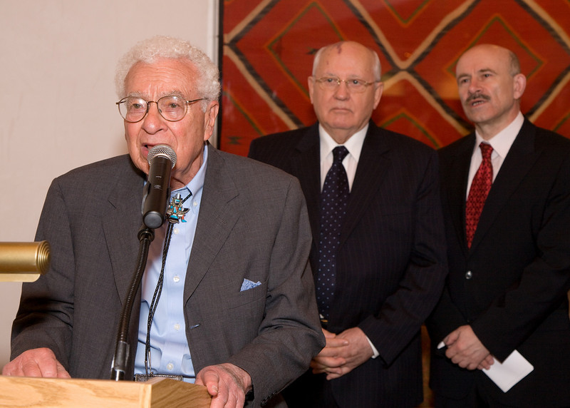 Nobel Laureate Dr. Murray Gell-Mann of the Santa Fe Institute introduces Nobel Laureate President Mikhail Gorbachev.  President Gorbachev's interpreter, Pavel Palazhchenko, on right.