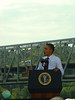 The president talking about his jobs bill with traffic finally reopened on the bridge after his arrival.