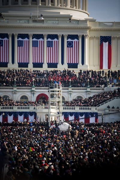Obama taking the oath - center balcony, below the red drapes, just left of Michelle (in the gold dress)