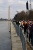 hiking home after the ceremony along the reflecting pool - Washington Monument and Capitol Bldg in background.