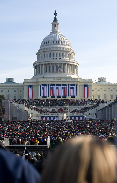 Just prior to Biden taking the Oath of Office. Itzhak Pearlman and Yo Yo Ma are seated in the blue area above the arch, about to perform