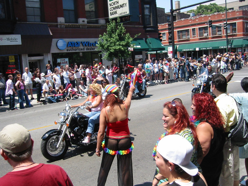 The faithful showing of Dykes on Bikes.  Hmmmm, that's a strange place to put a lei.  Hope she put sunscreen on those buns.