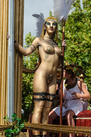 Female participant on a float decorated in the style of ancient Rome Pride Parade Ponsonby Road Auckland