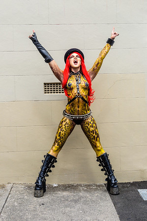 Woman participant with red hair wig, body paint and punk costume, ready for the Pride Parade Ponsonby Auckland