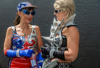 Two women in elaborate costumes, ready for the Pride Parade Ponsonby Auckland