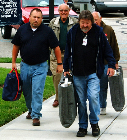 Diane Raver | The Herald-Tribune<br /> As Adams 3 inspector Mike Weiler (from left) and judge Tony Schath make their way to the courthouse, they are helped by two other gentlemen who helped carry in the voting machines.