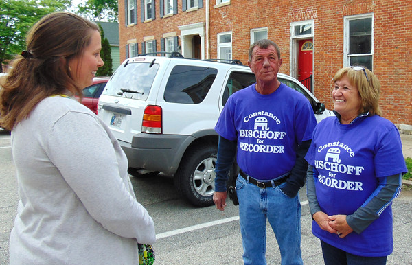 Sarah Dougan | The Herald-Tribune<br /> In Franklin County, unopposed Republican treasurer candidate and incumbent Veronica Voelker(from left) chats with Ken Bischoff, husband of winning Republican recorder candidate Constance Bischoff outside the courthouse as they wait for precinct results to arrive.
