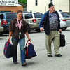 Sarah Dougan | The Herald-Tribune    <br /> Posey Township precinct clerk Donna Littrell's husband and granddaughter Erica Bates help carry election results into the courthouse.