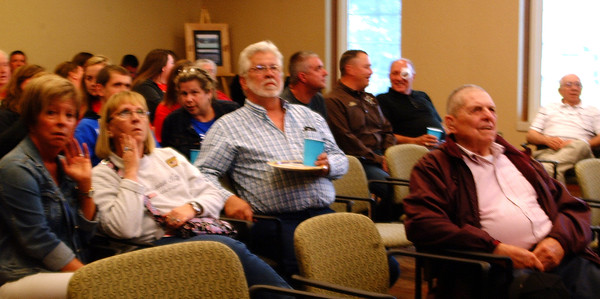 Diane Raver   The Herald-Tribune Current and retired county employees socialized while watching returns in Versailles.