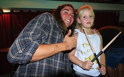 "Keith poses after the show with a young fan. She is an aspiring drummer who attended ""drum camp"" this summer and formed her own band called ""The Rockin' Mustaches"". Keith gave her his drum sticks  :-)"