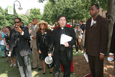"(L-r) Pastor Stephen Broden of the Fair Park Bible Fellowship Church, Dallas, Texas, Tim Johnson, chairman and founder of The Frederick Douglas Foundation, Raleigh, N.C, Day Gardner, president of the National Black Pro-Life Union, Washington, D.C., Father Frank Pavone, national director of Priests For Life, and Will Ford of Hilkiah Ministries, Dallas, Texas. are joined by over 100 supporters as they begin the pro-life service singing the Civil Rights anthem, ""We Shall Overcome."""