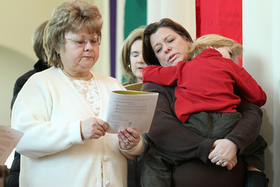 Debbie Gallo, left, and Julie Bugg, holding her four-year-old son Casey; Gallo and Bugg are members of Prince of Peace Church, Flowery Branch.
