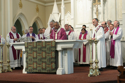Archbishop Wilton D. Gregory conducts the Liturgy of the Eucharist as his brother clergy join him on the altar.