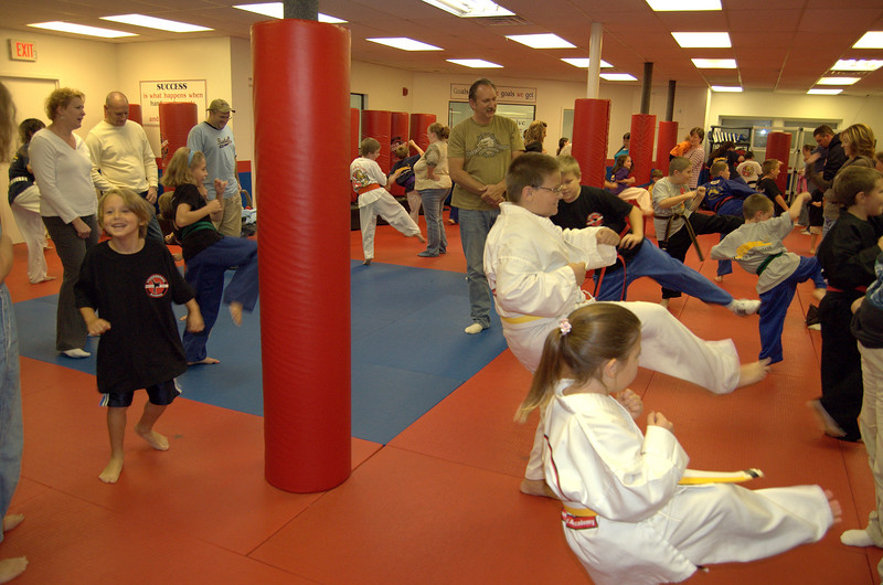 "27 students from Tim Barchard's Professional Martial Arts Academy in Derry, NH participate in a Kick-A-Thon to raise money to save ""The Met"" a children's museum also located in Derry, NH."