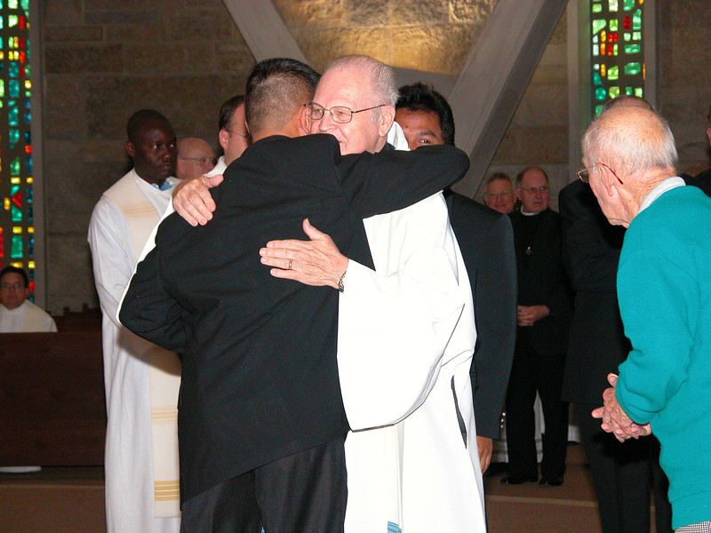 Long is congratulated and welcomed to the community by Fr. Michael van der Peet.