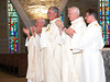 Fr. John Czyzynski, Fr. Tom Cassidy, Fr. Michael Burke and Dn. Mark Mastin celebrate Long and Clay's intention to profess vows.