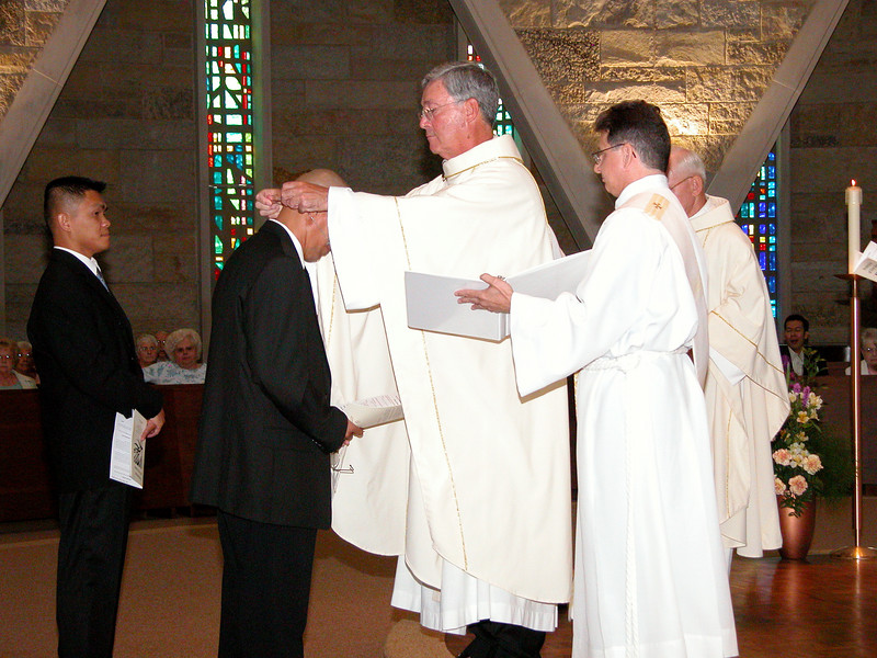 Clay receives his profession cross.
