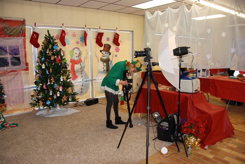 Santa's elf puts away her camera.