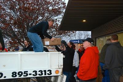 Taking turkeys off the truck.