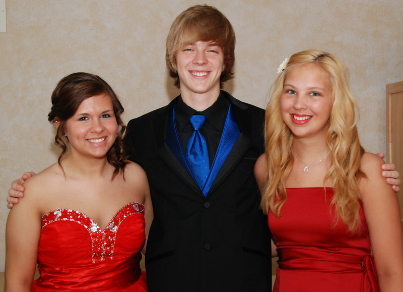 Jeremy Cassiday with friends Zoey Brennan, left, and Jayme Wyble, right. They came to take pictures before they went to prom at Bellevue East. Jeremy went to Bellevue West's prom.