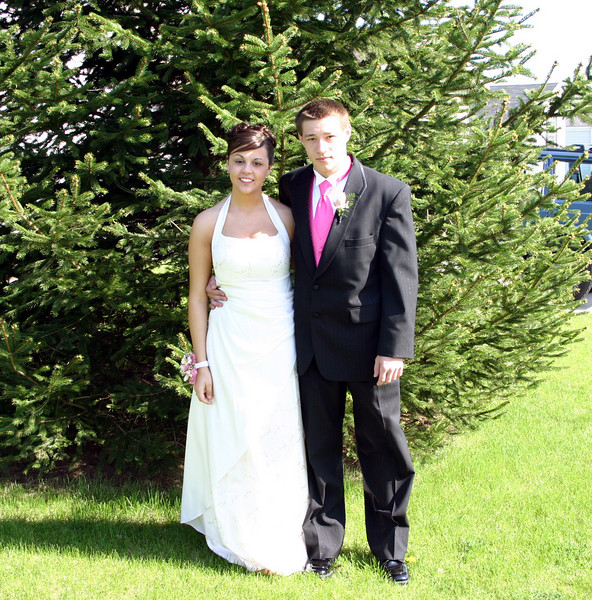 Erin and Alex posing for pictures before the Wilton Prom  ( 2007 )