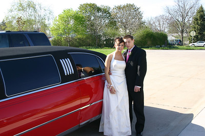 Erin and Alex beside the limousine that will be taking them to dinner.  ( 2007 )