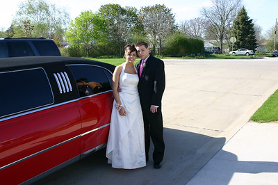 Alex and Erin by the limousine that will be taking them to the prom.  ( 2007 )
