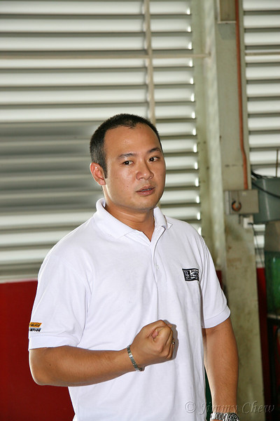 "<font color=""yellow"">Tengku Djan emphasising some points on the performance cars.</font><br>"