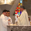 Fr. Mark Mastin and Frater Duy Nguyen assist Fr. Tom Cassidy.