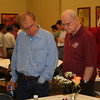 Fr. Bob Tucker and Fr. Michael van der Peet review work done at one of the tables.