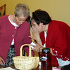 Sr. Barbara Stanbridge, moderator, and Lisa Brahm quietly share information while delegates do an exercise.
