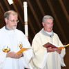 Fr. Claudio Dalla Zuanna, general councilor, and Fr. Tom Cassidy, provincial superior, process into the closing Mass.