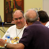 Fr. Charlie Bisgrove listens to SCJs at his table.