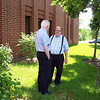 Fr. Mike Burke and Fr. Yvon Sheehy chat on break.