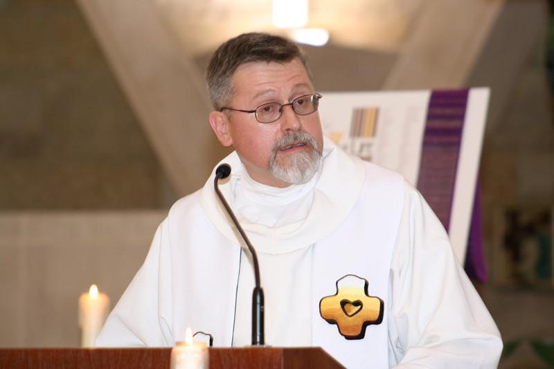Fr. Ed Zemlik proclaims the Gospel.