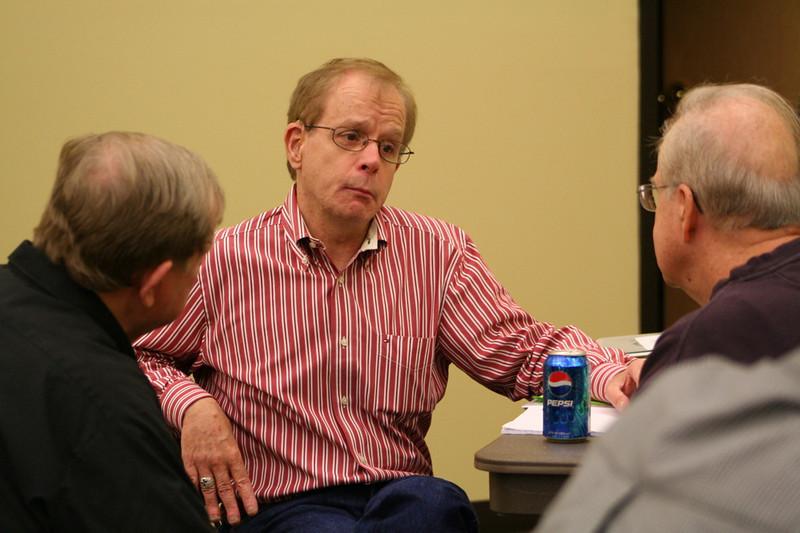 Fr. Bob Tucker listens to Fr. John Klingler.