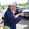 Fr. Dominic Peluse checks out the brats.
