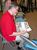 Fr. Ed Zemlik faithfully reads his new SCJ NEWS.  No, this wasn't a posed photo!