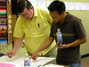 Fr. Anthony Kluckman (left) and Frater Duy Nguyen review their small group's report.
