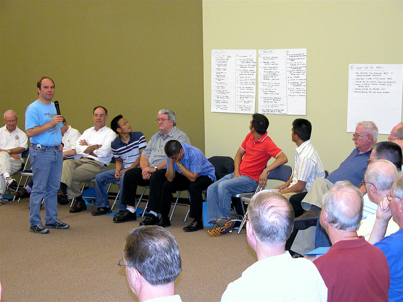 Fr. David Szatkowski reports on his small group's talk.