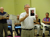 Fr. Lenny Elder, coordinator of the SCJ community in Mississippi, holds a photo of Fr. John Young. Fr. John had ministered in Mississippi for many years before dying in 2005.
