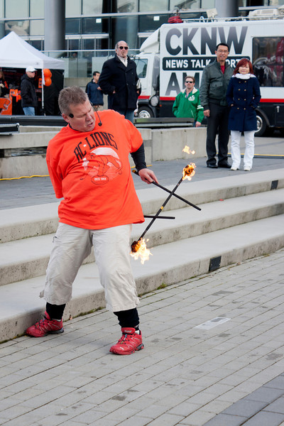 Mike Battie juggles fire during 2011 Grey Cup festivities.