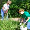 <b>Nancy Marshall and friend weeding</b> <i>- Kay Larche</i>