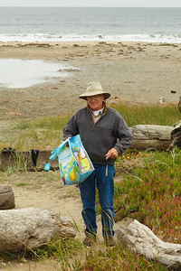 Pete Linhares collecting trash on Drakes Beach.