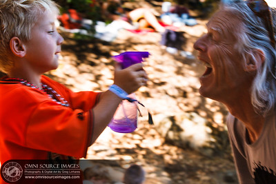 Keeping Cool at the Mount Tam Jam wasn't easy, but scores of children with spray bottles helped everyone stay hydrated! This is one of those spontaneous moments when there simply was no time to adjust camera settings, and even the the shutter was too slow (1/15 sec), this essence of this moment still comes through very nicely.