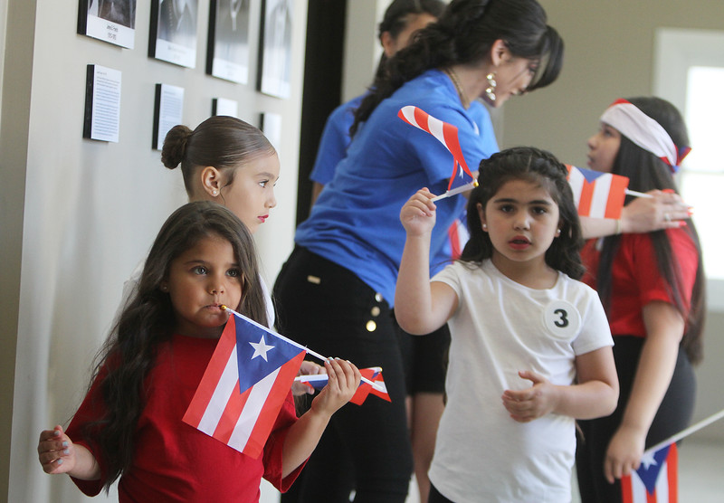Hijos de Borinquen beauty pageant, part of the Lowell Puerto Rican Festival. From left, contestants Janezly Maldonado-Cruz, 5,, Aiyanah Restrepo, 6, Kaylan Caraballo, 15, Jamileth Cabrera, 6, and Lionelee Oyola, 10. (SUN/Julia Malakie)